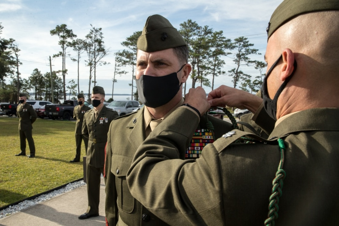 U.S. Marines with 1st Battalion 8th Marine Regiment, 2d Marine Division, are presented the French Fourragere during a dedication ceremony on Camp Lejeune, North Carolina, Nov. 25, 2020. V1/8 is one the few units in 2d Marine Division that is not organic to 6th Marine Regiment to ever receive the French Fourragere. The French Fourragere was originally awarded to 5th and 6th Marine Regiments for their historic accomplishments in France during the First World War.(U.S. Marine Corps photo by Cpl. Elijah J. Abernathy)