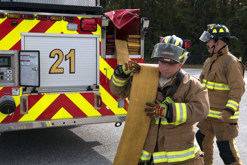 Christopher Swift, a driver operator for the 628th Civil Engineer Squadron, helps Airmen and civilian firefighters prepare for a training exercise, at Joint Base Charleston, S.C., Dec. 3, 2020. Swift and his team members at the 628th CES Fire Department support the mission by saving lives and protecting the people of Joint Base Charleston.