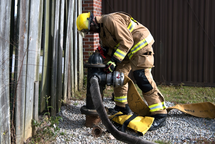 Airman 1st Class Hedrige Evra, a firefighter for the 628th Civil Engineer Squadron, connects a firehose to a fire hydrant to ensure water flows correctly through the hose, at Joint Base Charleston, S.C., Dec. 3, 2020. Swift and his team members at the 628th CES Fire Department support the mission by saving lives and protecting the people of Joint Base Charleston.