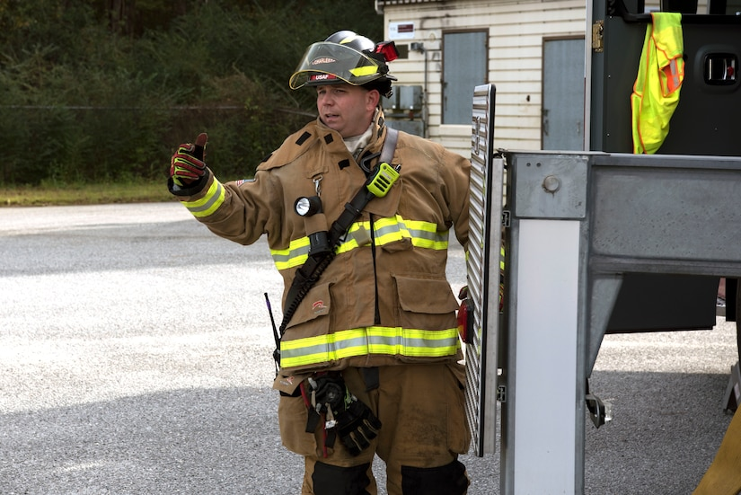 Christopher Swift, a driver operator for the 628th Civil Engineer Squadron, signals to start the training exercise, at Joint Base Charleston, S.C., Dec. 3, 2020. Swift and his team members at the 628th CES Fire Department support the mission by saving lives and protecting the people of Joint Base Charleston.
