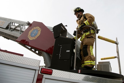 Danny Drake, a firefighter from the 628th Civil Engineer Squadron, begins to extend a hydraulic operated aerial ladder to a nearby training building to begin the process of ascending the building safely, at Joint Base Charleston, S.C., Dec. 3, 2020. Swift and his team members at the 628th CES Fire Department support the mission by saving lives and protecting the people of Joint Base Charleston.