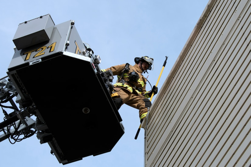 Chaz Cools, a firefighter from the 628th Civil Engineer Squadron, begins to mount himself to the top of the training building, at Joint Base Charleston, S.C., Dec. 3, 2020. Swift and his team members at the 628th CES Fire Department support the mission by saving lives and protecting the people of Joint Base Charleston.