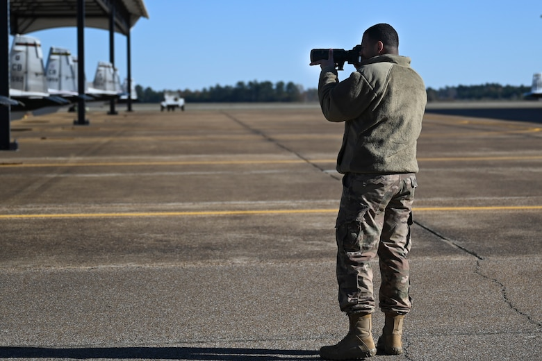 U.S. Air Force Senior Airman David Richardson, 14th Operations Support squadron aircrew flight equipment technician, practices photographing aircraft during a job swap with Public Affairs Nov. 11, 2020, on Columbus Air Force Base, Miss. Air Force Public Affairs advances Air Force priorities and achieves mission objectives through integrated planning, execution, and assessment of communication capabilities. (U.S. Air Force photo by Airman 1st Class Jessica Williams)