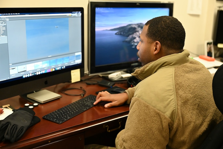 U.S. Air Force Senior Airman David Richardson, 14th Operations Support squadron aircrew flight equipment technician, looks through his recently captured photos on Microsoft Bridge Nov. 30, 2020, on Columbus Air Force Base, Miss. The Department of Defense uses a variety of editing software to include Microsoft Bridge, Premier, Photoshop and InDesign as an effort to ensure quality products are being produced. (U.S. Air Force photo by Airman 1st Class Jessica Williams)
