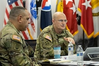 Gen. Edward Daly, U.S. Army Materiel Command commanding general, held a discussion with leaders of the U.S. Army Financial Management Command while Command Sgt. Maj. Alberto Delgado, AMC senior enlisted advisor, listens during a quarterly update at the Maj. Gen. Emmett J. Bean Federal Center in Indianapolis Nov. 20, 2020. The visit was the first in-person visit made by Daly and Delgado to USAFMCOM since the general took command of AMC in July. (U.S. Army photo by Mark R. W. Orders-Woempner)