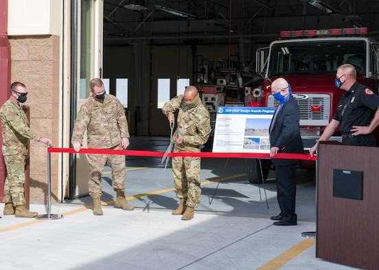Col. Randel Gordon, 412th Test Wing Vice Commander, cuts the ribbon to officially open the new Airfield Fire Station at Edwards Air Force Base, California, Dec. 8. (Air Force photo by Giancarlo Casem)