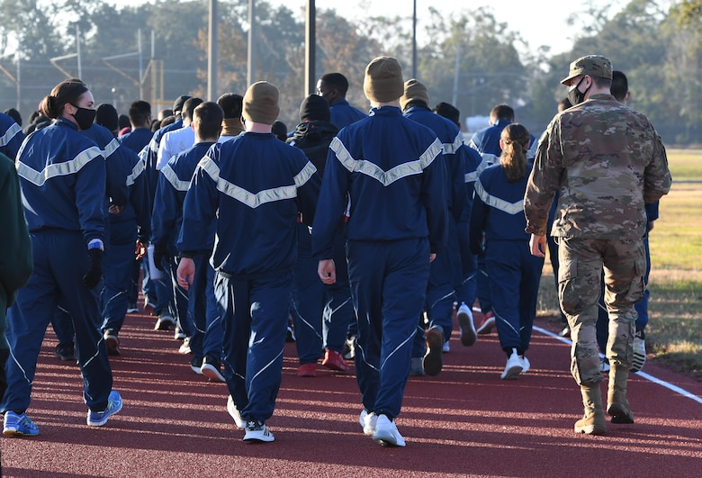 "U.S. Air Force Col. Heather Blackwell, 81st Training Wing commander, walks with Airmen from the 81st Training Group during the Dragon March on the triangle track at Keesler Air Force Base, Mississippi, Dec. 8, 2020. The theme of the three-mile walk was ""Stronger Together."" (U.S. Air Force photo by Kemberly Groue)"
