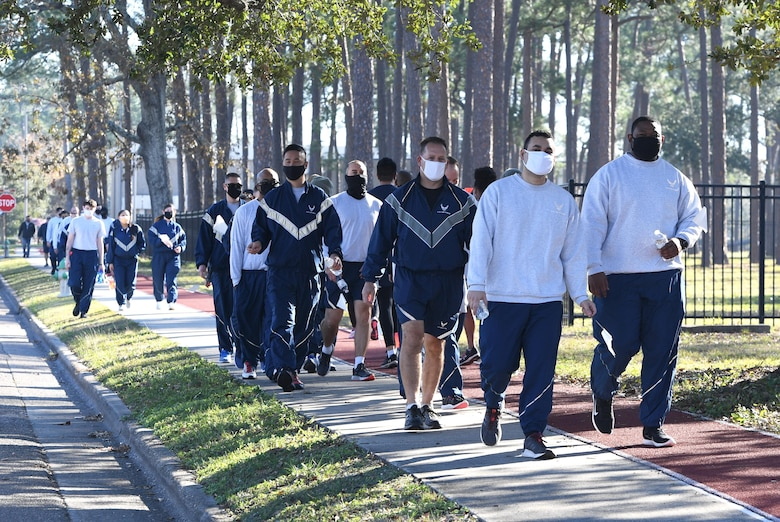 "Members of the 338th Training Squadron participate in the Dragon March at Keesler Air Force Base, Mississippi, Dec. 8, 2020. The theme of the three-mile walk was ""Stronger Together."" (U.S. Air Force photo by Kemberly Groue)"
