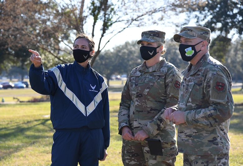 "U.S. Air Force Col. Heather Blackwell, 81st Training Wing commander, points out the rally point to Chief Master Sgt. Sarah Esparza, 81st TRW command chief, and Chief Master Sgt. Erik Thompson, command chief of Air Education and Training Command, at Heritage Field during the Dragon March at Keesler Air Force Base, Mississippi, Dec. 8, 2020. The theme of the three-mile walk was ""Stronger Together."" (U.S. Air Force photo by Kemberly Groue)"