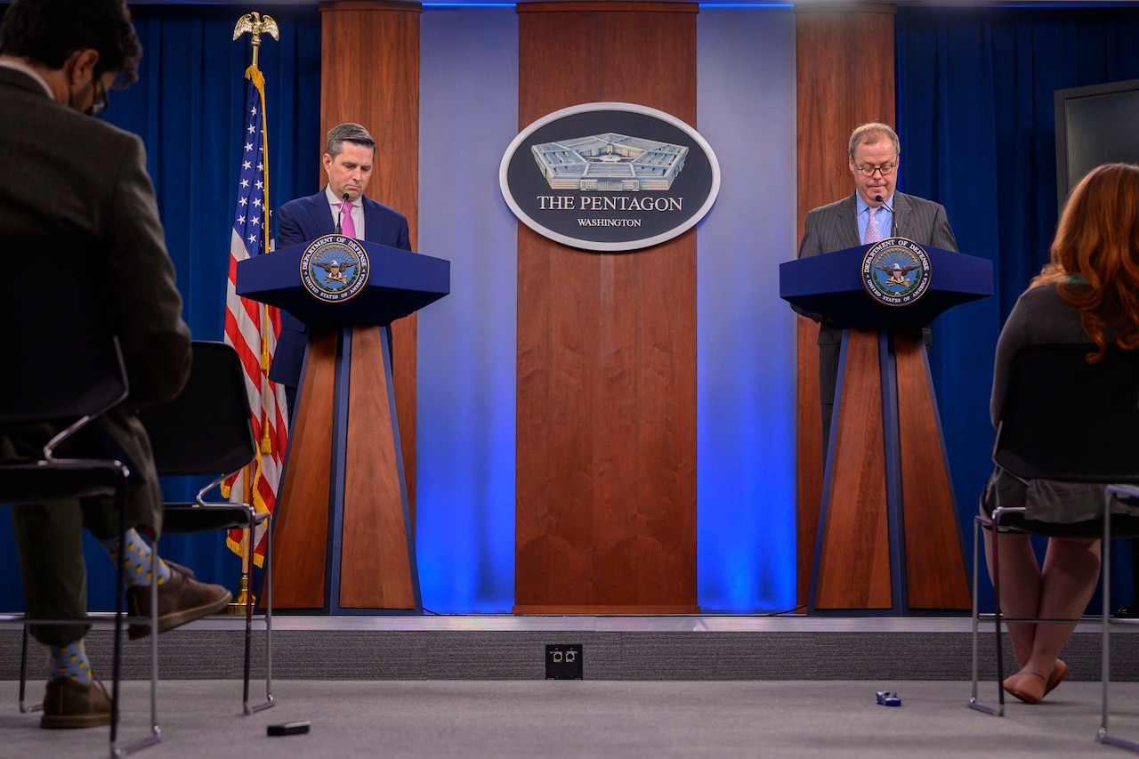 Two men brief reporters at the Pentagon.