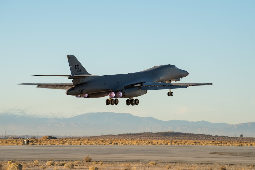 A B-1B Lancer assigned to the 419th Flight Test Squadron, 412th Test Wing, takes off from Edwards Air Force Base, California, Dec. 4. The mission's flight crew conducted an external release demonstration with a Joint Air-to-Surface Standoff Missile attached to an external pylon. (Air Force photo by Richard Gonzales)