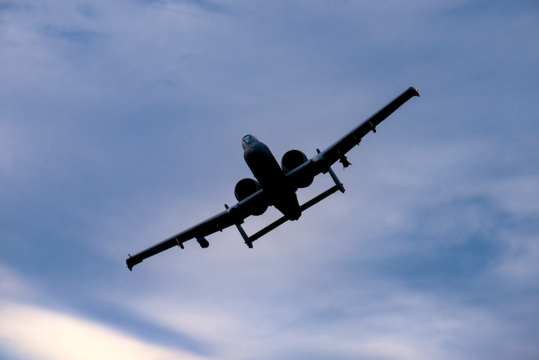 A photo of an A-10 Thunderbolt II flying over the Warren Grove Gunnery Range