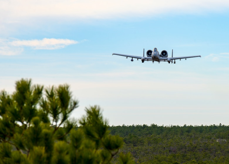 A photo of an A-10 Thunderbolt II flying over the Warren Grove Gunnery Range