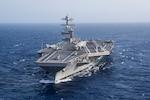 An air craft carrier sails in the open ocean