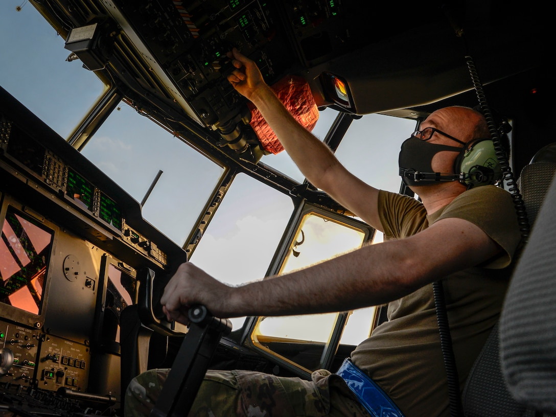 Staff Sgt. Joshua Smith, 374th Aircraft Maintenance Squadron integrated flight controls systems craftsman from Yokota Air Base, Japan, goes over the C-130J Super Hercules' instruments during a pre-flight inspection during Operation Christmas Drop 2020 at Andersen Air Force Base, Guam, Dec. 9.