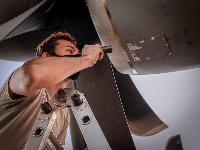 Senior Airman Stephen Yarbrough, 374th Aircraft Maintenance Squadron crew chief Yokota Air Base, Japan, inspects the engine of a C-130J Super Hercules during Operation Christmas Drop 2020 at Andersen Air Force Base, Guam, Dec. 9.