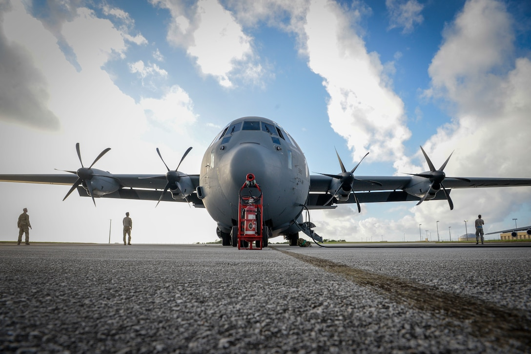 Airmen from the 374th Aircraft Maintenance Squadron out of Yokota Air Base, Japan, inspect the propellers of a C-130J Super Hercules during Operation Christmas Drop 2020 at Andersen Air Force Base, Guam, Dec. 9.