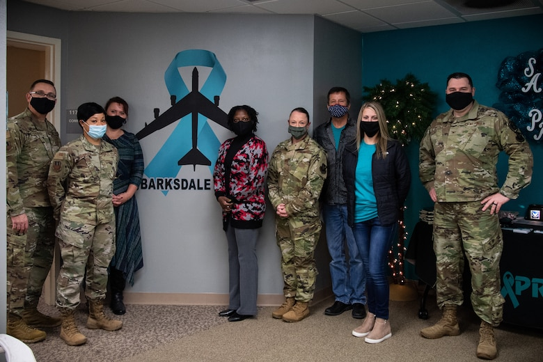 The Sexual Assault Prevention and Response (SAPR) team poses for a group photo with the 2nd Bomb Wing command team at Barksdale Air Force Base, La., Dec. 4, 2020.