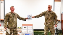 Master Sgt. Ian Garcia, left, 2nd Civil Engineer Squadron section chief explosive ordnance disposal logistics, poses for a photo with Col. Randy Whitecotton, right, 2nd Mission Support Group commander, at Barksdale Air Force Base, La., Dec. 1, 2020.