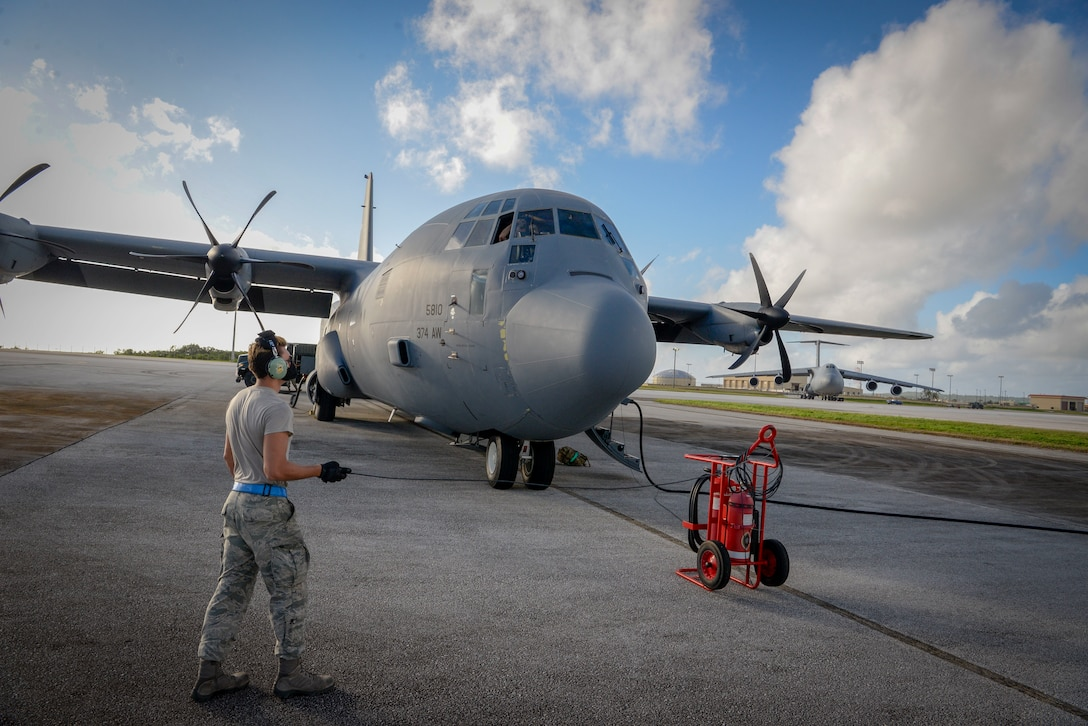 Senior Airman Stephen Yarbrough, 374th Aircraft Maintenance Squadron crew chief from Yokota Air Base, Japan, communicates with the rest of his team aboard a C-130J Super Hercules via radio during the refueling process at Operation Christmas Drop 2020 at Andersen Air Force Base, Guam, Dec. 9.