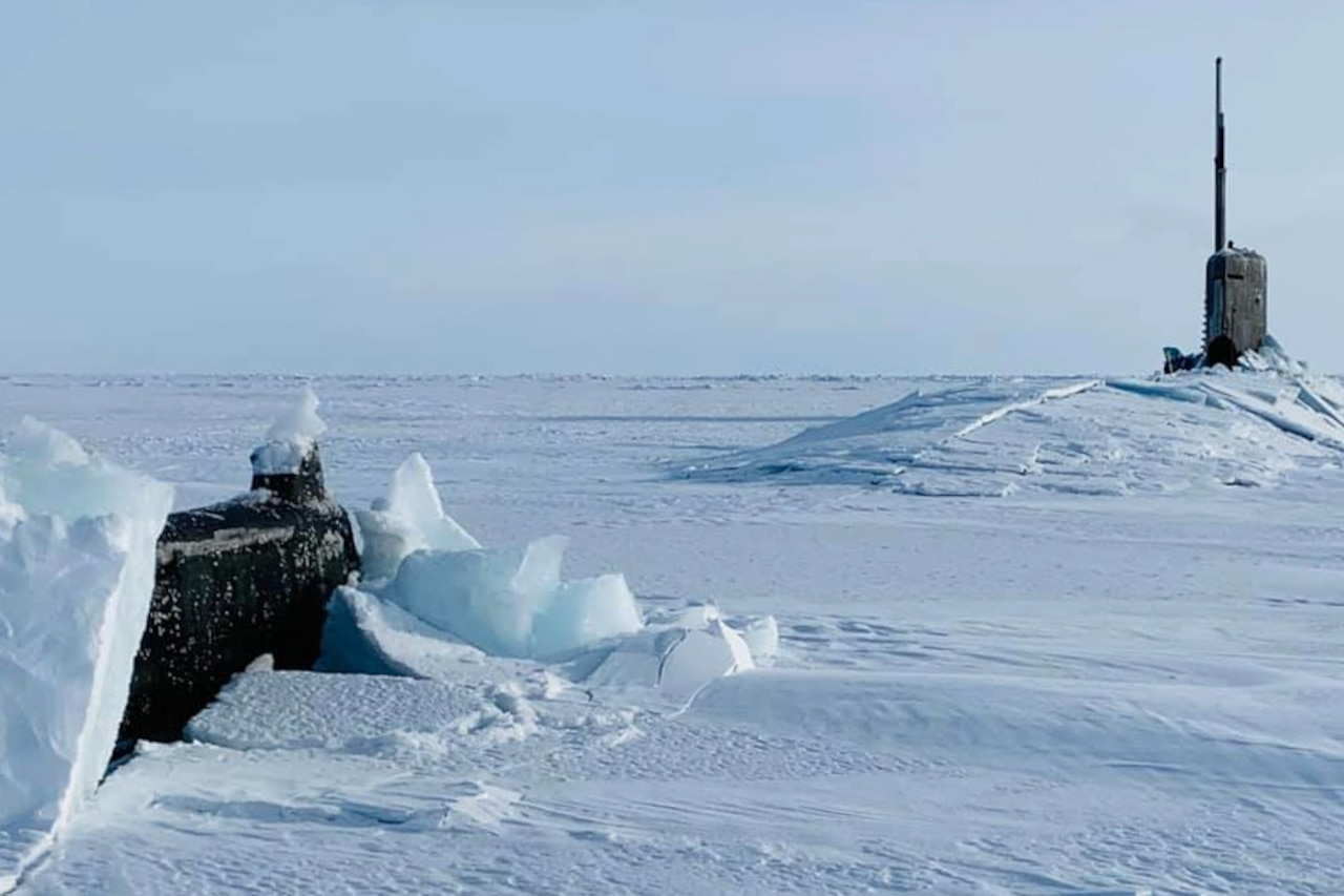 A submarine breaks through a sheet of ice as it comes to the surface.