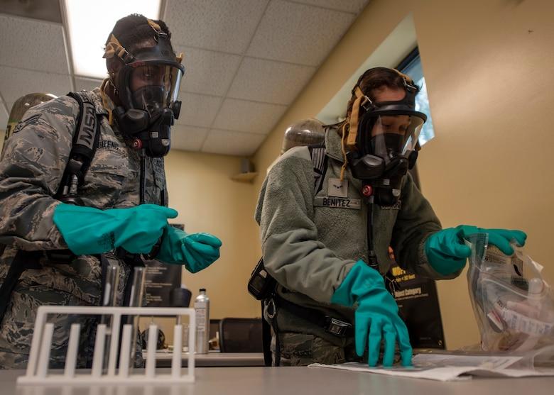 Engineer Squadron emergency managers, take a swipe sample during training at Seymour Johnson Air Force Base, North Carolina, Nov. 19, 2020.