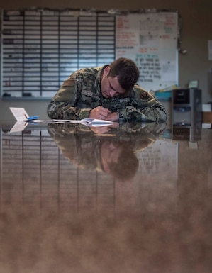 An Airman fills out a form to register as a bone marrow donor.