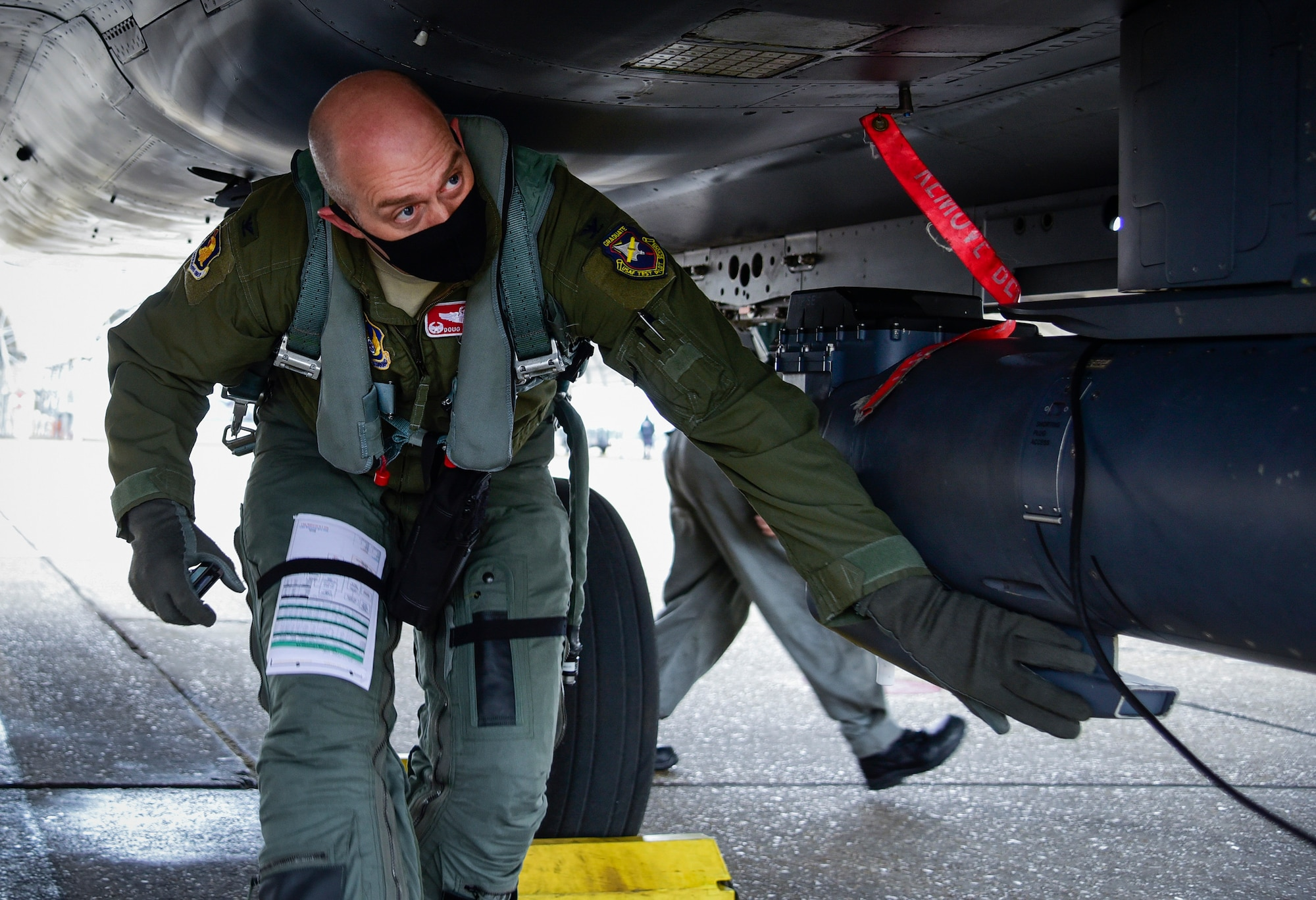 Col. Douglas Creviston, 96th Operations Group commander, performs preflight checks prior to an Emerald Flag mission at Eglin Air Force Base, Fla., Dec. 3, 2020. Emerald Flag was a collaborative multi-service effort focused on increasing the effectiveness of the joint domain warfighter. (U.S. Air Force photo by 1st Lt. Karissa Rodriguez)