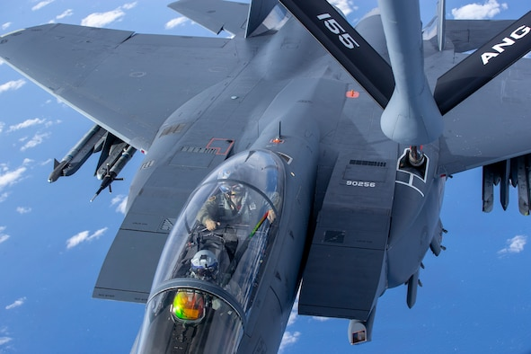 A 96th Test Wing F-15E Strike Eagle prepares for in-flight refueling from a 155th Air Refueling Wing KC-135 Stratotanker during exercise Emerald Flag over the Gulf of Mexico, Dec. 3, 2020. More than 25 agencies participated in the exercise at Eglin Air Force Base, Fla. The exercise incorporated ground, space, cyberspace and air platforms for joint test and experimentation. (U.S. Air Force photo by Staff Sgt. Joshua Hoskins)