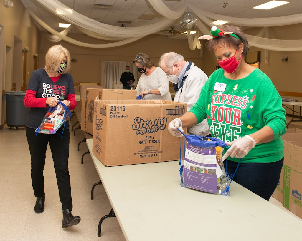 Stand alone photo of Bellevue Chamber filling holiday bags for Offutt dorm residents