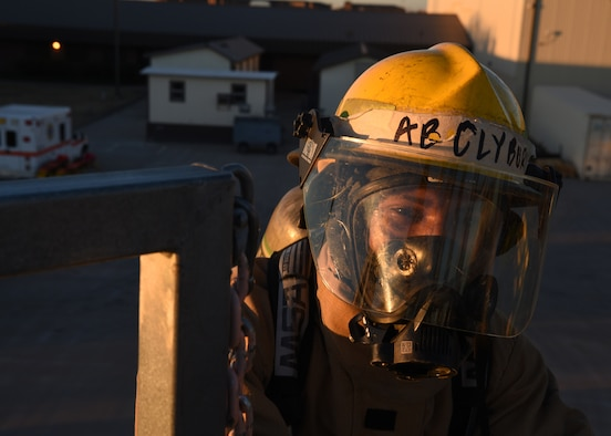 """U.S. Air National Guard Airman Toryon Clyburn, 312th Training Squadron fire protection student, arrives at the egress point in order to join his partner on the artificial rooftop in an emergency operations training exercise, at the Louis F. Garland Department of Defense Fire Academy on Goodfellow Air Force Base, Texas, Dec. 10, 2020. Clyburn followed a strict rule of """"two in, two out,"""" which required the buddy system in the fire service whenever operating in an """"Immediately Dangerous to Life and Health"""" atmosphere, such as vertical ventilation training. (U.S. Air Force photo by Senior Airman Abbey Rieves)"""