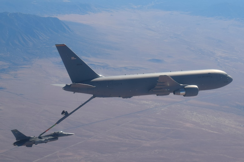 In the skies over New Mexico, an F-16 Fighting Falcon from the 49th Wing at Holloman Air Force Base (AFB), New Mexico, receives fuel from a KC-46 Pegasus from the 56th Air Refueling Squadron at Altus AFB, Oklahoma, December 7, 2020. This is the first time an Air Education and Training Command KC-46 has made contact with and transferred fuel to an F-16. (Courtesy photo by 1st Lt. Daniel Lee)