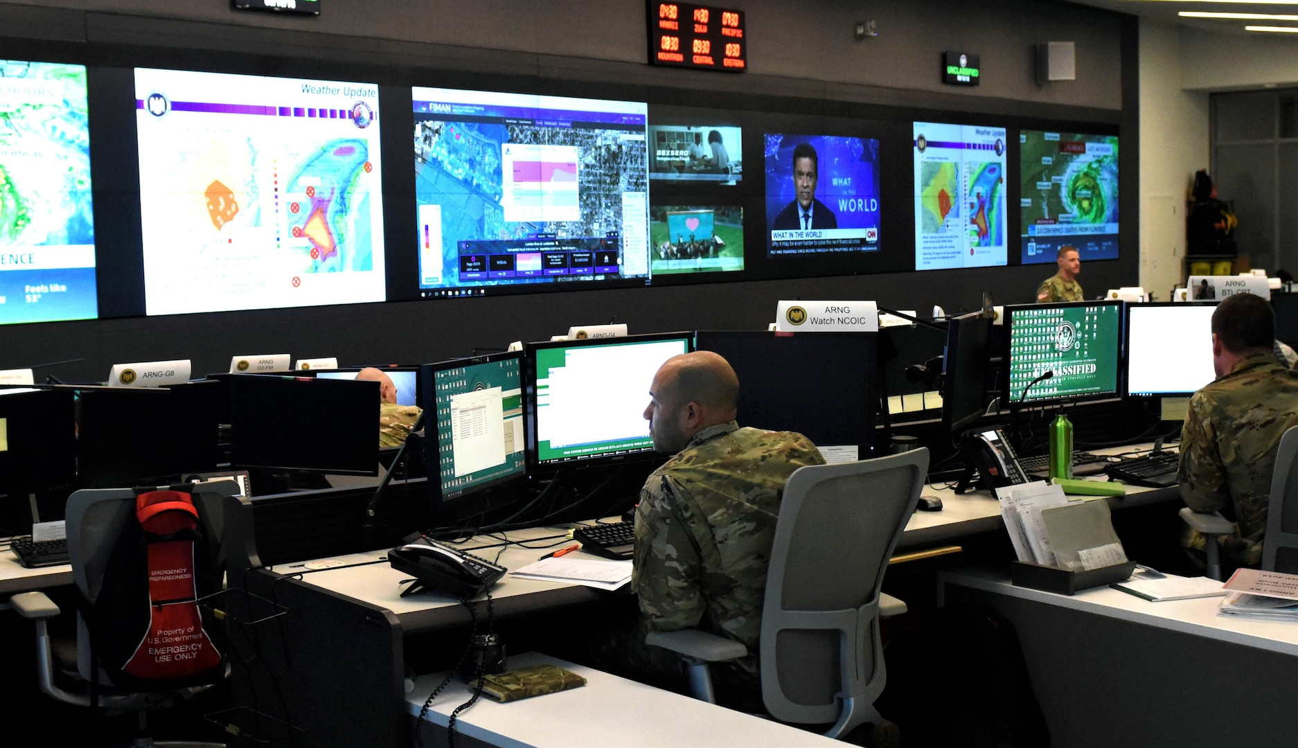 National Guard members monitor Guard activity stemming from Hurricane Florence at the National Guard Coordination Center in Arlington, Virginia, Sept. 16, 2018. In 2020, the NGCC helped coordinate response activities with federal agency partners to ensure Guard units had what they needed to support local and state authorities during the coronavirus pandemic, civil unrest, cyber events and natural disasters.