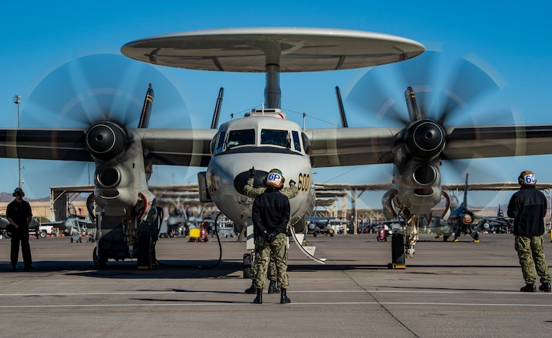 U.S. Navy Airmen prepare an aircraft for take-off.