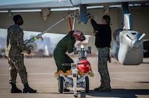 U.S. Navy Airmen work on aircraft