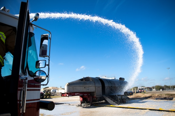 Firefighters with Joint Base San Antonio extinguish an isolated fire during a live fire Aircraft Rescue Fire Fighting training Nov. 20, 2020, at Joint Base San Antonio-Lackland Kelly Field Annex.