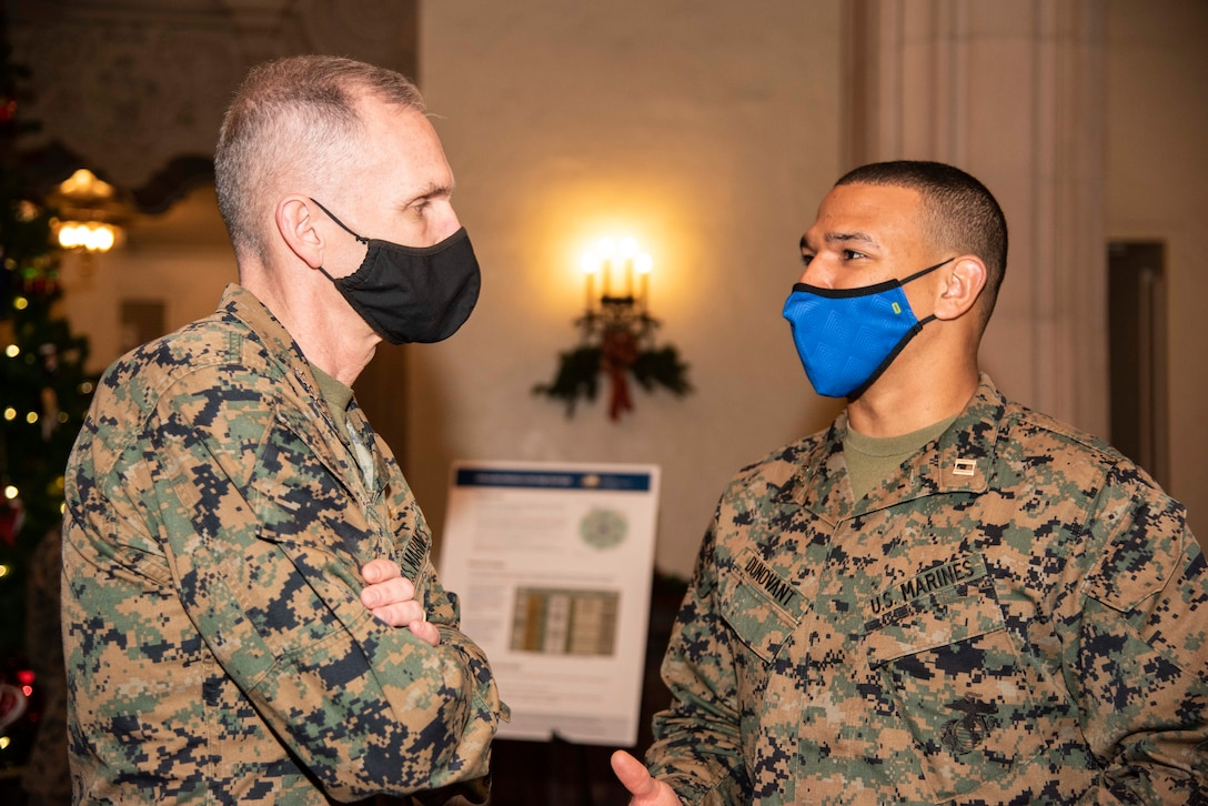 Assistant Commandant for the Marine Corps Gen. Gary Thomas talks with Naval Postgraduate School Information Warfare student Marine Corps Capt. Matt Dunovant during a visit to the university, Dec. 9.