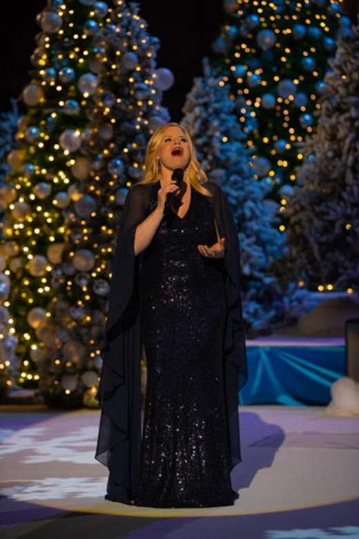 "Broadway sensation Megan Hilty performs with the U.S. Air Force Concert Band and Singing Sergeants during their holiday special, ""Season of Hope,"" performed at the MGM National Harbor in Oxon Hill, Maryland. (U.S. Air Force Photo by Chief Master Sgt. Kevin Burns)"