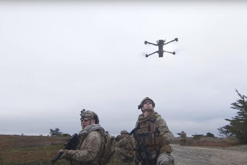 Drone flies above troops.