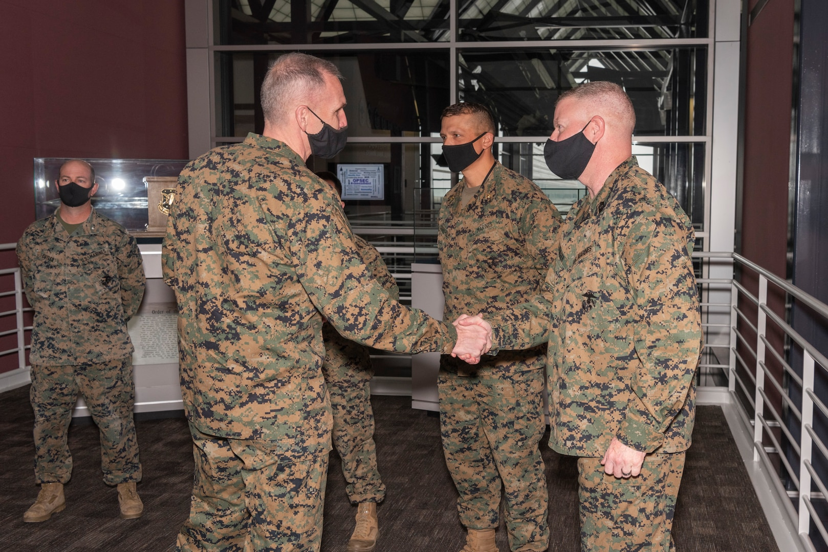 U.S. Marine Corps Master Gunnery Sgt. Scott Stalker (right), U.S. Space Command command senior enlisted leader, greets Gen. Gary Thomas, assistant commandant of the Marine Corps on Dec. 11, 2020, at USSPACECOM headquarters at Peterson Air Force Base, Colorado.