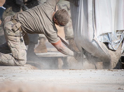 Airmen from the 378th Expeditionary Civil Engineer Squadron repair a roadway as part of an exercise Dec. 4, 2020, at Prince Sultan Air Base, Kingdom of Saudi Arabia.