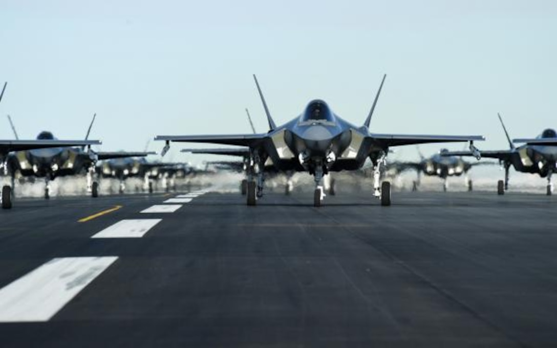 An F-35, prepped for flight sits on the runway.