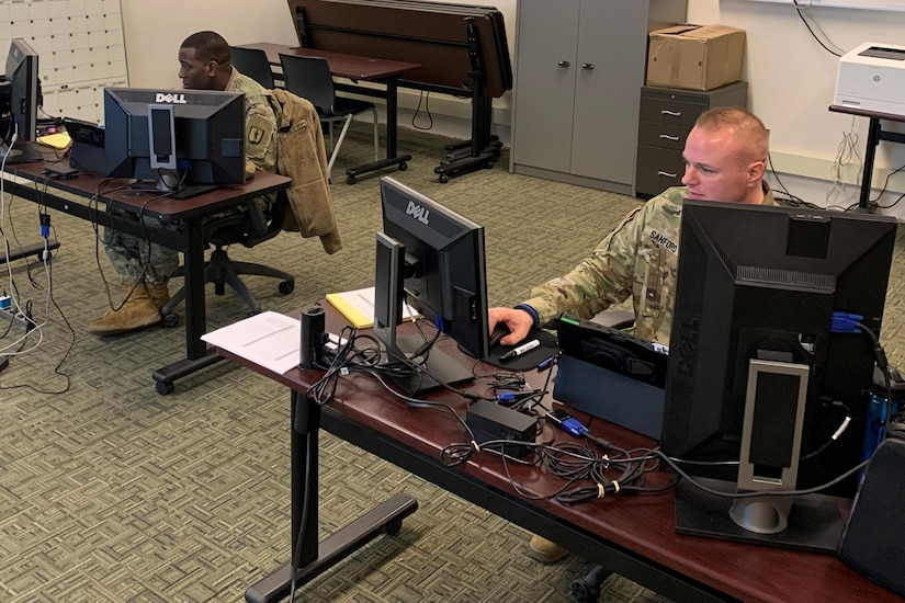 Staff Sgt. Vito Lyde of the South Carolina National Guard (left) and Staff Sgt. Max Sanford of the North Dakota National Guard, instructors with the new Army National Guard-Forward Virtual Basic Leadership Course, teach a class from the 166th Regiment Regional Training Institute at Fort Indiantown Gap, Pa.