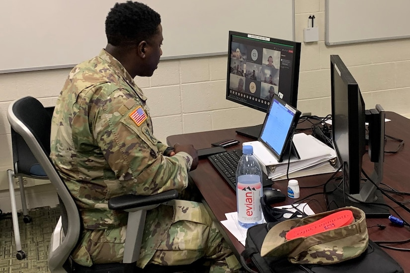 Staff Sgt. Sidney Ruth of the South Carolina National Guard, an instructor with the new Army National Guard-Forward Virtual Basic Leadership Course, teach a class from the 166th Regiment Regional Training Institute at Fort Indiantown Gap, Pa.