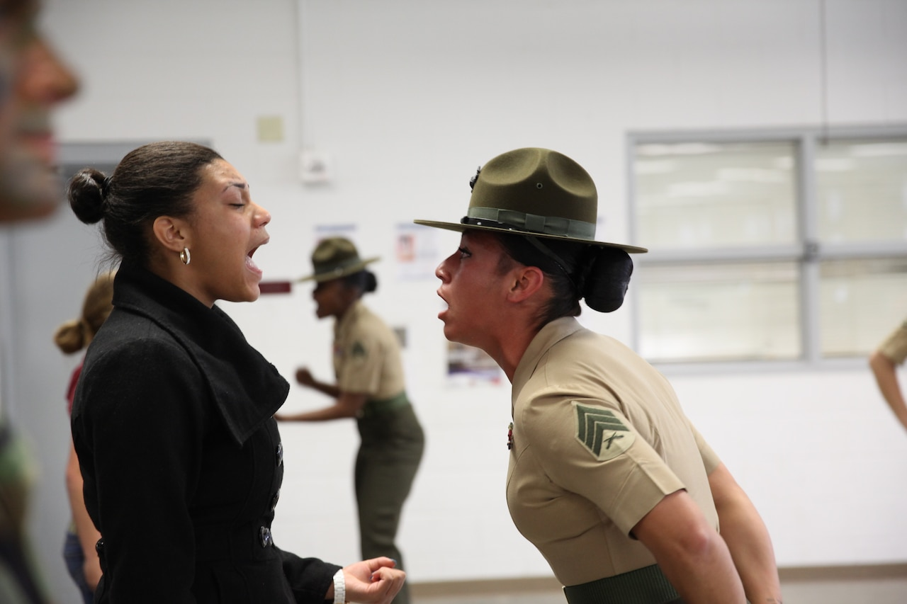 An NCO yells at a recruit.