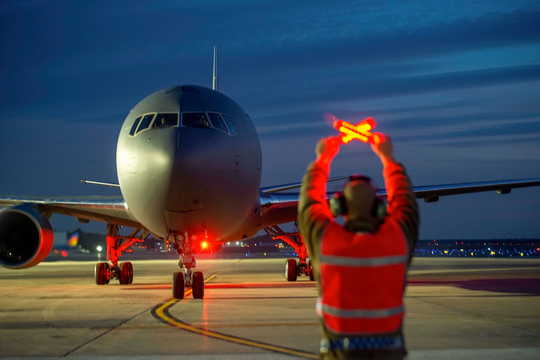 An airman signals an aircraft.