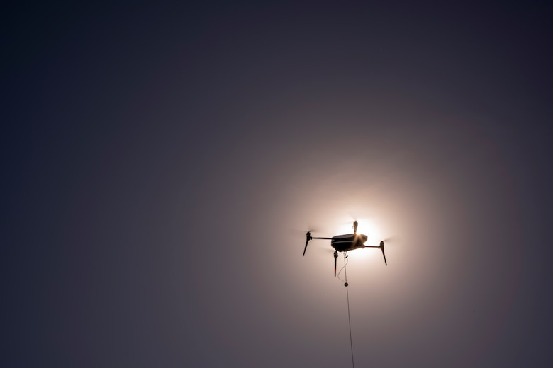 A picture of a drone in the air.