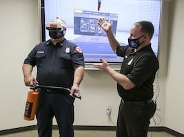 Mike Pinan, Assistant Chief for Fire Prevention, showcases the latest Edwards AFB Fire and Emergency Services' newest training tool. (Air Force photo by Giancarlo Casem)