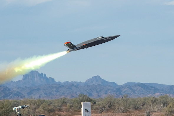 An XQ-58A Valkyrie low-cost unmanned aerial vehicle launches at the U.S. Army Yuma Proving Ground, Ariz., Dec. 9, 2020. The acquisition team – comprised of Air Force Research Laboratory and Air Force Life Cycle Management Center personnel working in conjunction with Eglin Air Force Base, Fla.'s 46th Test Squadron – came together to conduct the historic test.