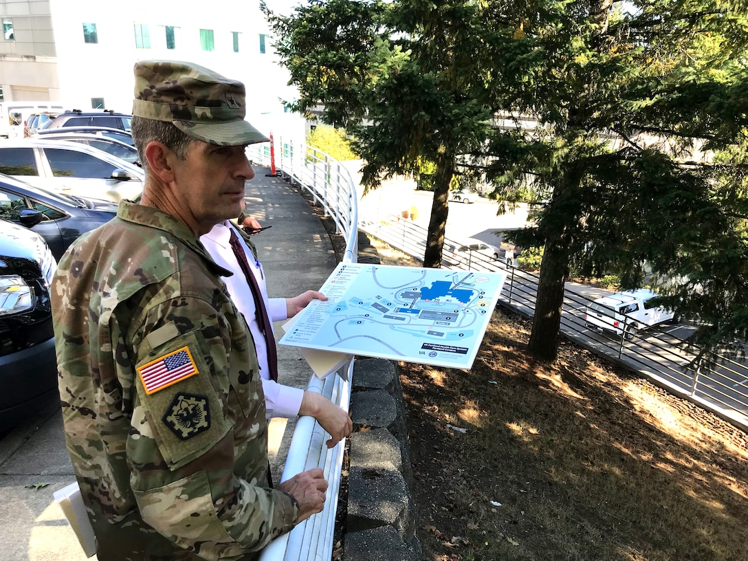 Brigadier General Peter Helmlinger, Northwestern Division commander, toured the Portland Veteran's Affairs Medical Center (PVAMC) with Portland District, U.S. Army Corps of Engineers team members who are working on designs and plans to retrofit the PVAMC, Sept. 28, 2018. The tour was a way for District staff to discuss the difficulties the team will face during seismic retrofitting.